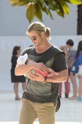 Awwwww! Chris Hemsworth cradles daughter India Rose at Thyssen Museum in Madrid, Spain on July 4, 2012