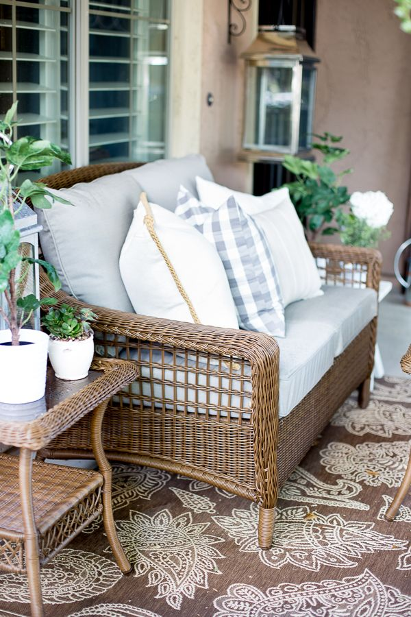 The Hampton Bay Spring Haven Patio Sofa looks smashing on this patio styled by Destiny Alfonso of the home and lifestyle blog Just Destiny Mag. See her gorgeous French-style courtyard on The Home Depot Blog. || @justdestinymag