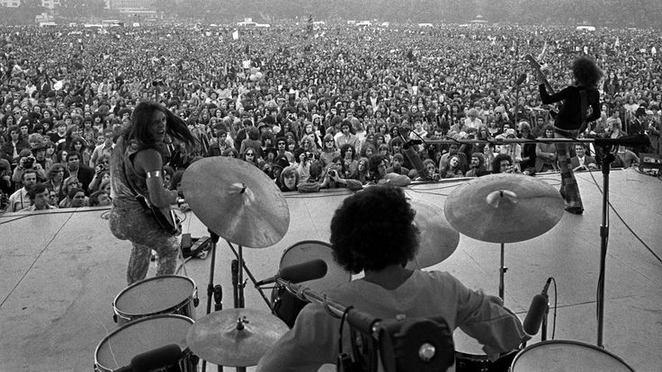 Grand Funk Railroad: Mark Farner (on left, switching between guitar and organ), Mel Schacher (bass) and Don Brewer (drums), play a free concert in London's Hyde Park, July 3, 1971 – their UK debut. Over 100,000 attended the show, with Humble Pie (featuring Peter Frampton) among the opening acts.
