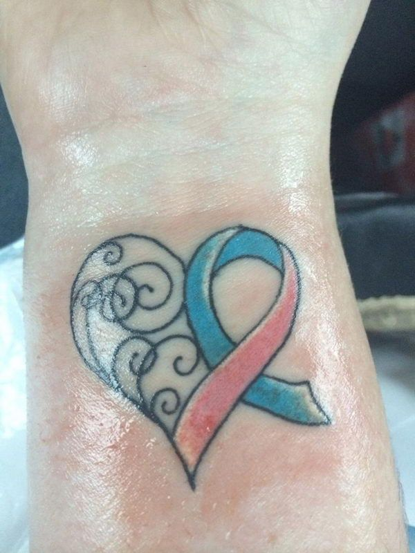 11 ribbon heart on wrist http://hative.com/inspiring-miscarriage-tattoos/... this is definitely happening and soon, Its perfect for me.