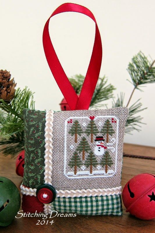 I think I'll try to finish my next one like this.  Stitching Dreams: 2014 Parade of Ornaments!
