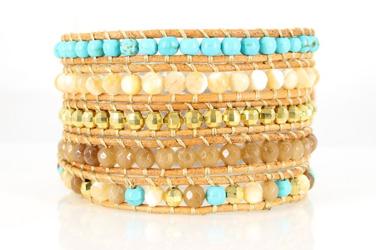 ULURU Wrap Bracelet by #Beautiz. Beautiful 5 layer handcrafted leather wrap bracelet. Real Turquoise, White Agate and Quartz Stones with golden metal beads. Stainless Steel and Nickel-Free Clasp. Shop here: http://www.beautiz.net/english/fashion-jewelry/bracelets/wrap-bracelets/uluru.html