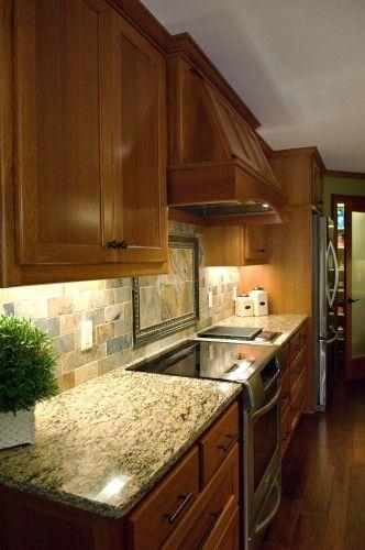 Lyptus hardwood cabinets with slate backsplash, design by J Carsten Homes & Remodeling. http://jcarstenhomes.com/