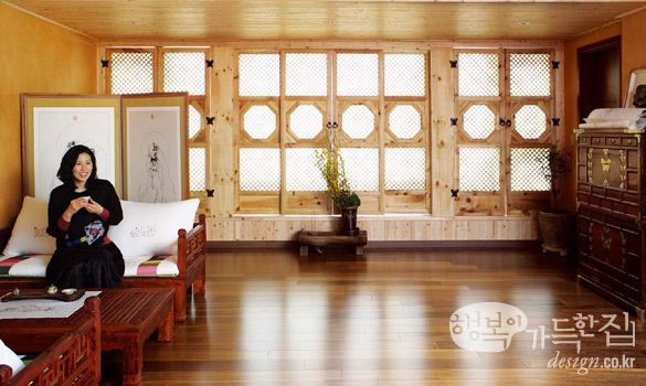 Modern Hanok living room. Love the wall decorated with traditional doors.