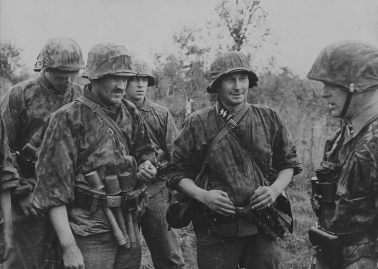 Voldemārs Veiss (right), the second-in-command for 2. Lettische SS-Freiwilligen Brigade which will become 19. Waffen Grenadier Division der SS (lettische Nr 2) in January 1944, briefs his troops in September 1943 when the unit successfully went into action to contest a hill on the River Volkhov. Veiss was awarded the Iron Cross during the fighting in September 1943, and in February 1944 become the first Latvian to earn the Knight's Cross, after succesfully defending Nekokhovo from repeated…