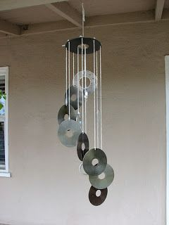 CD Wind Chime - all you need are old CD's and string. Perfect, quick and easy. Very effective. Upcycle garden craft ideas.