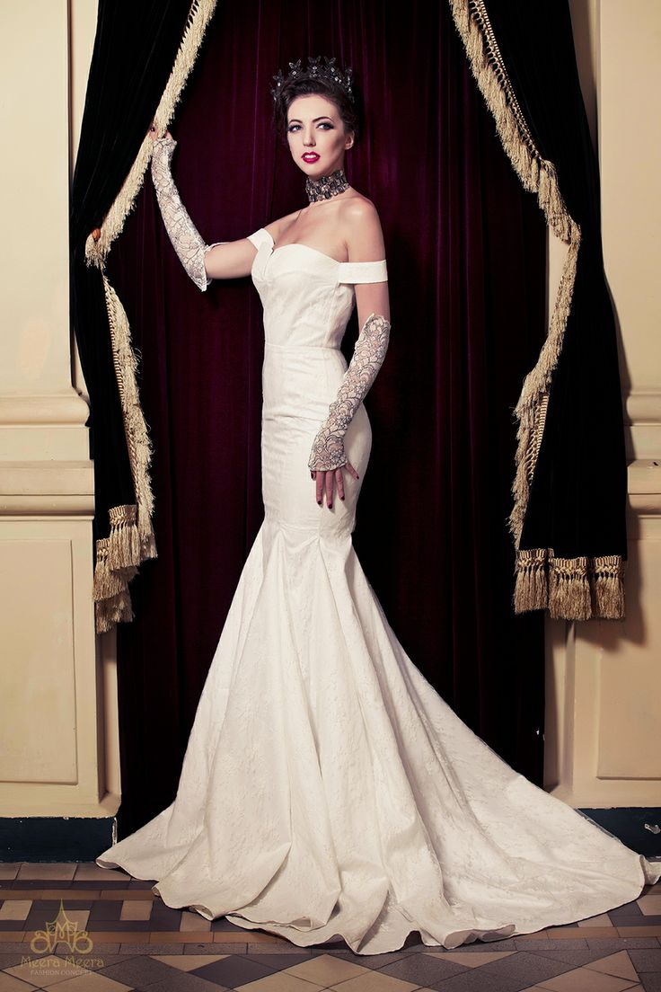 Strapless mermaid wedding dress with cut-out detail and architectural seaming gown. See more at:http://www.weddinginspirasi.com/2013/12/05/meera-meera-fall-2013-wedding-dresses/