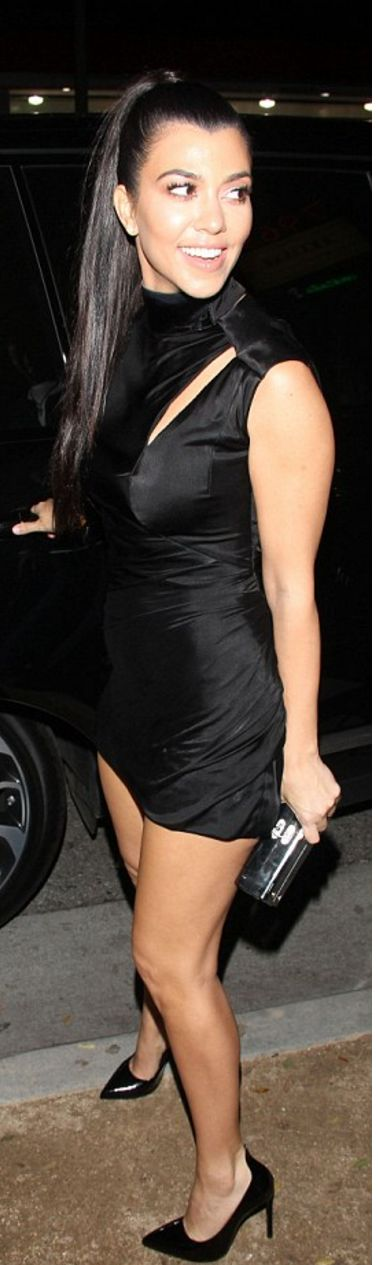 Who made  Kourtney Kardashian's black pumps and ruched cut out dress?