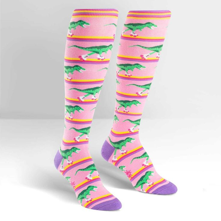 Knee high ladies dinosaur socks. Fun socks featuring dinosaurs whizzing around a pink rawr-ler rink! One size fits most. We were the first in the UK to import