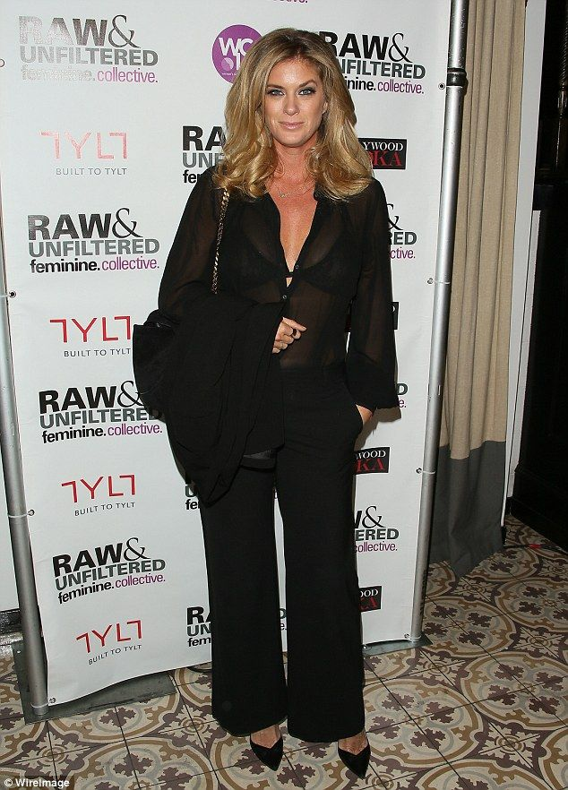 Rachel Hunter, 46, flaunts her ample assets in a plunging jumpsuit as she shows off her balance moves | Daily Mail Online