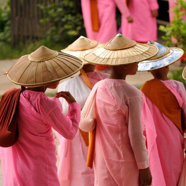Novice nuns in downtown Hsipaw Burma. The pink against the green of the trees in town made for a cool scene. #oldcuts #travel #myanmar by glenthomsonphoto