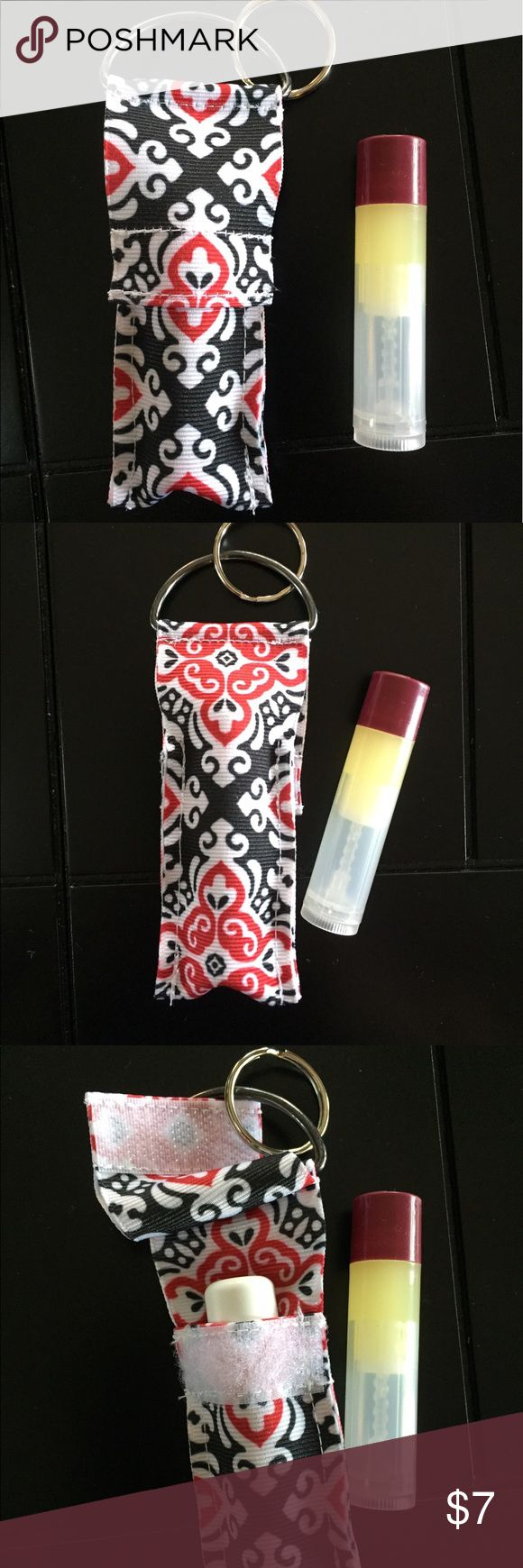 Blk & Red Mosaic lip balm holder My patent/copyright holder is perfect for anyone who loses or misplaces their lip balm. This holder can attach to key chains, lanyards, name tags, purses, bags, sports bags, etc.   Lip balm not included.  This holder fits regular size lip balm.  My patent/copyright holder has a flap closure to ensure your lip balm will stay put. Pat. D778043 Makeup Lip Balm & Gloss