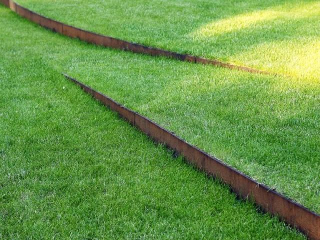 corten steps within lawn