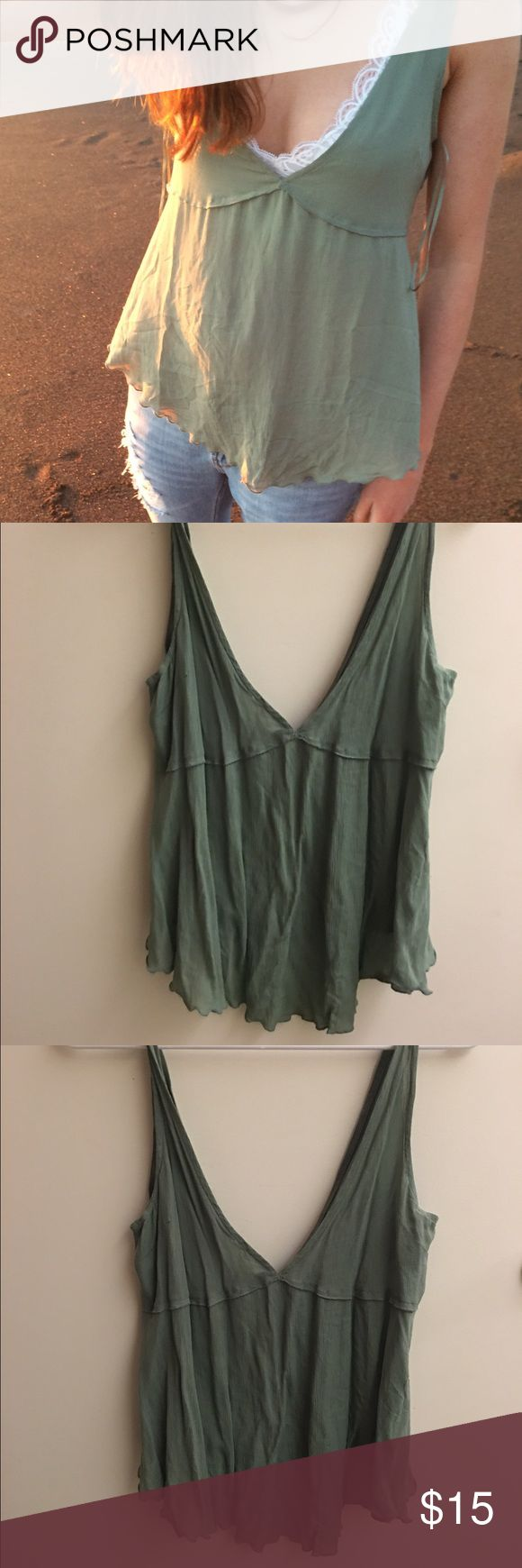 Free People Green V-Cut Tank Top Free People green, v-cut flowy tank top. Perfect for the spring/summer and for layering. Very cute and in great condition! Free People Tops Tank Tops