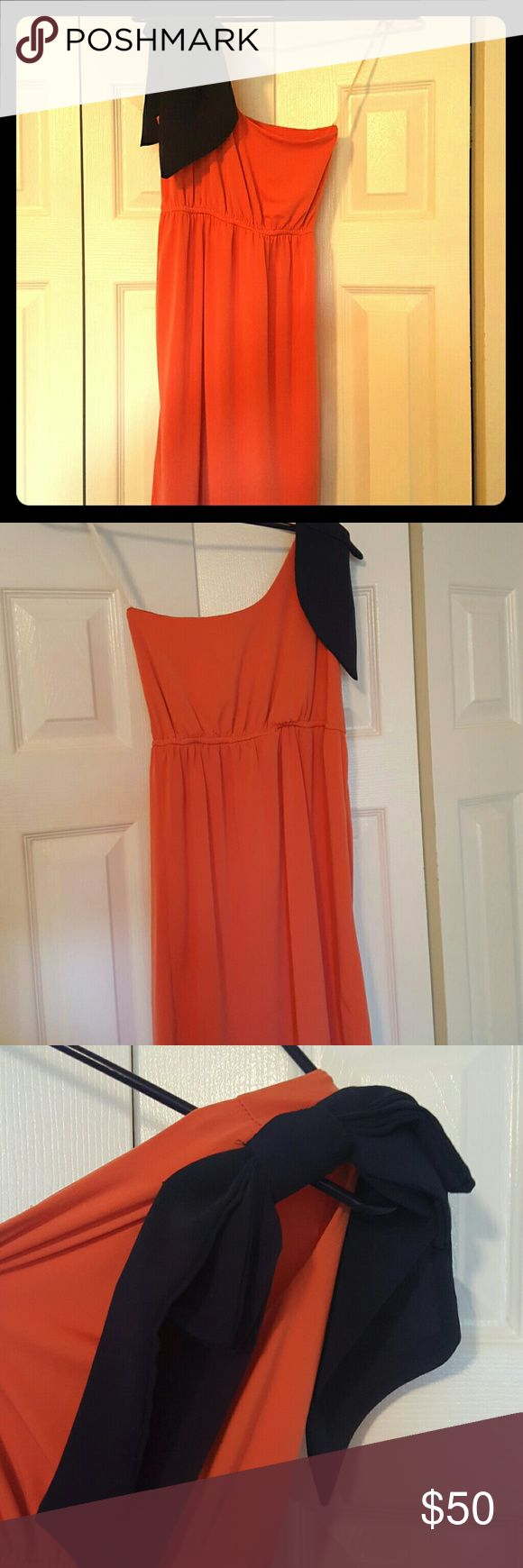 Judith March One-shoulder Dress Stunning Orange dress with Blue bow on shoulder. Great for a summer day or Saturday football games rooting on your school. Great Condition, only wore 1 time. Judith March Dresses One Shoulder
