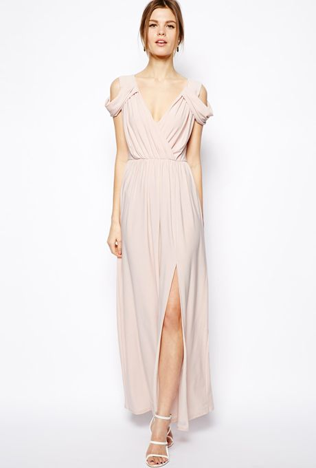 Brides.com: Affordable (and Stylish!) Bridesmaid Dresses Under $100 . Wrap front maxi dress, $84.69, ASOS  See more pink bridesmaid dresses.
