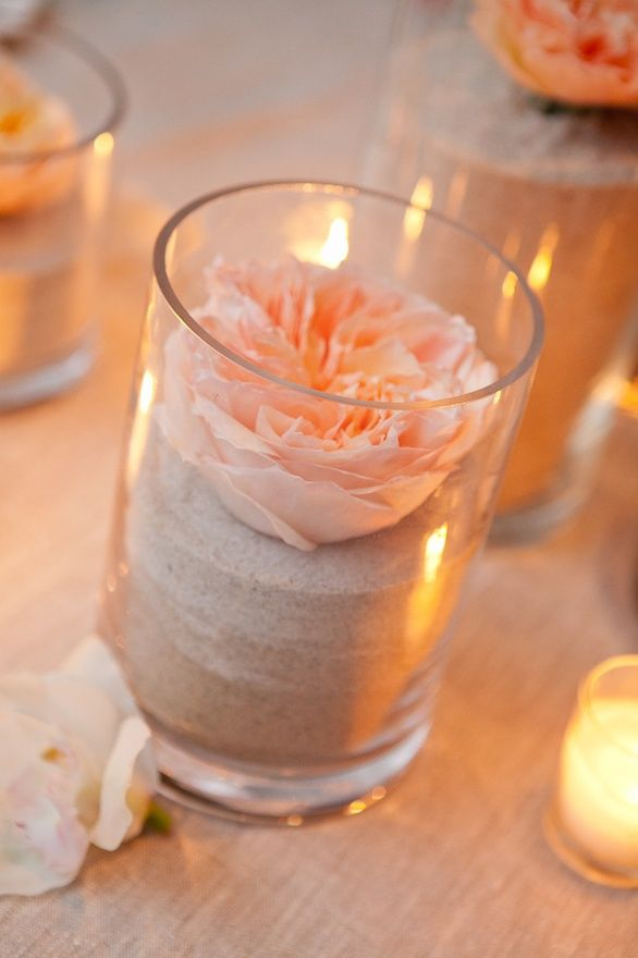 Flower/Sand for a beach wedding centerpiece.  <3    LOVE THIS IDEA!!