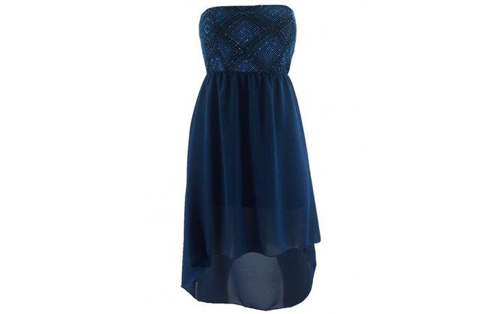 Het perfecte kerst jurkje. Dit is een strapless model, met een luchtige chiffon stof. De jurk heeft een turquoise onderjurk. De bovenkant van de jurk is turquoise met een patroon. Combineer met feestelijke pumps.