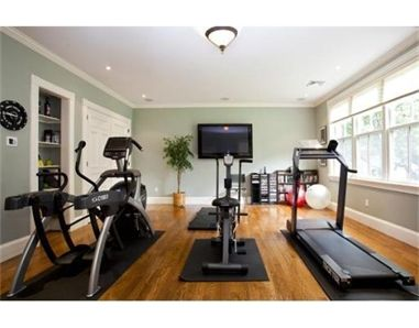 A dream home gym: elliptical, treadmill, spin bike, boxing, room for workout DVDs, exercise ball, weights