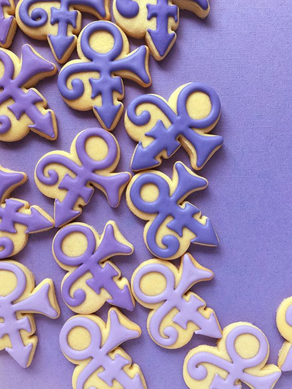 Dearly Beloved... this listing is for 2 dozen (24) Prince symbol cookies in shades of purple. Each cookie is 3 tall, and is individually heat