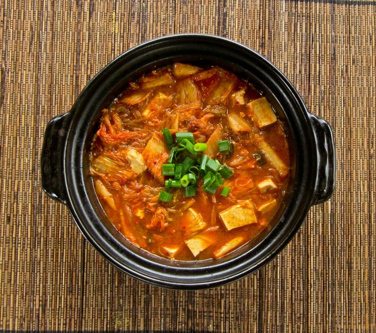 Kimchi Jjigae: A Korean stew made from kimchi, vermicilli and tofu! Spicy, tangy and absolutely delicious!