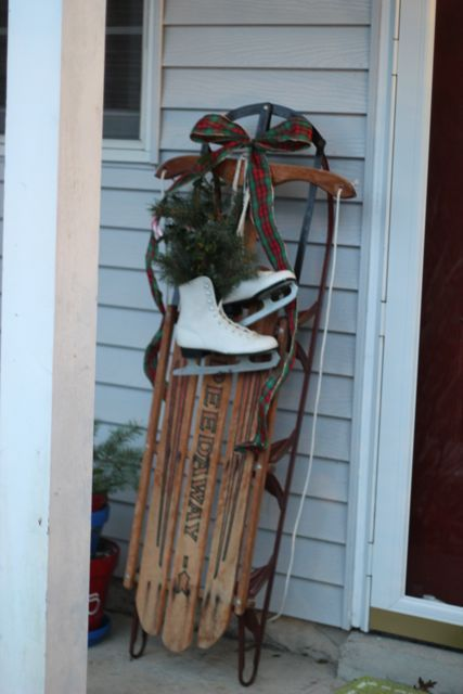 winter decor. we have an old sled that belonged to the hubby, guess what next years door is going to look like : )