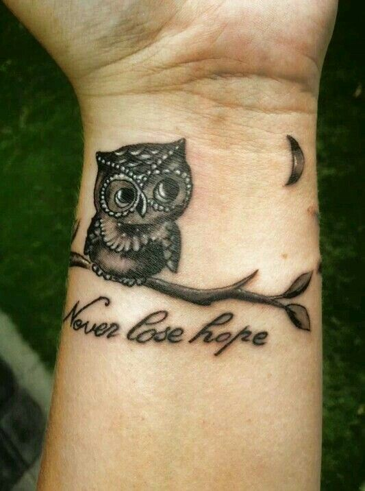 Never lose hope. Cute little owl tattoo.. Not a huge fan on wrist tattoos but beautiful placement :)