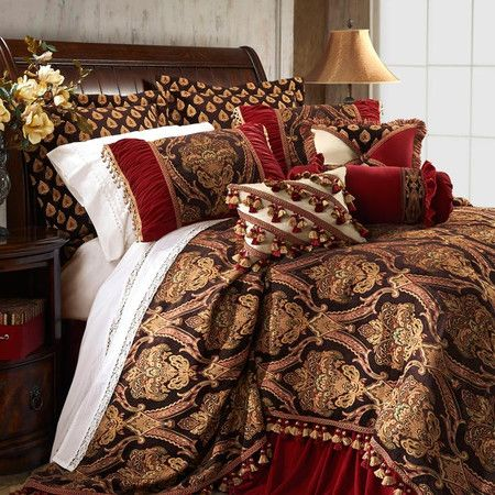 Bedding set with a jacquard floral motif and tassel trim.  Product: Queen: 1 Comforter, 2 standard shams, 1 bed skirt, 2 Euro...