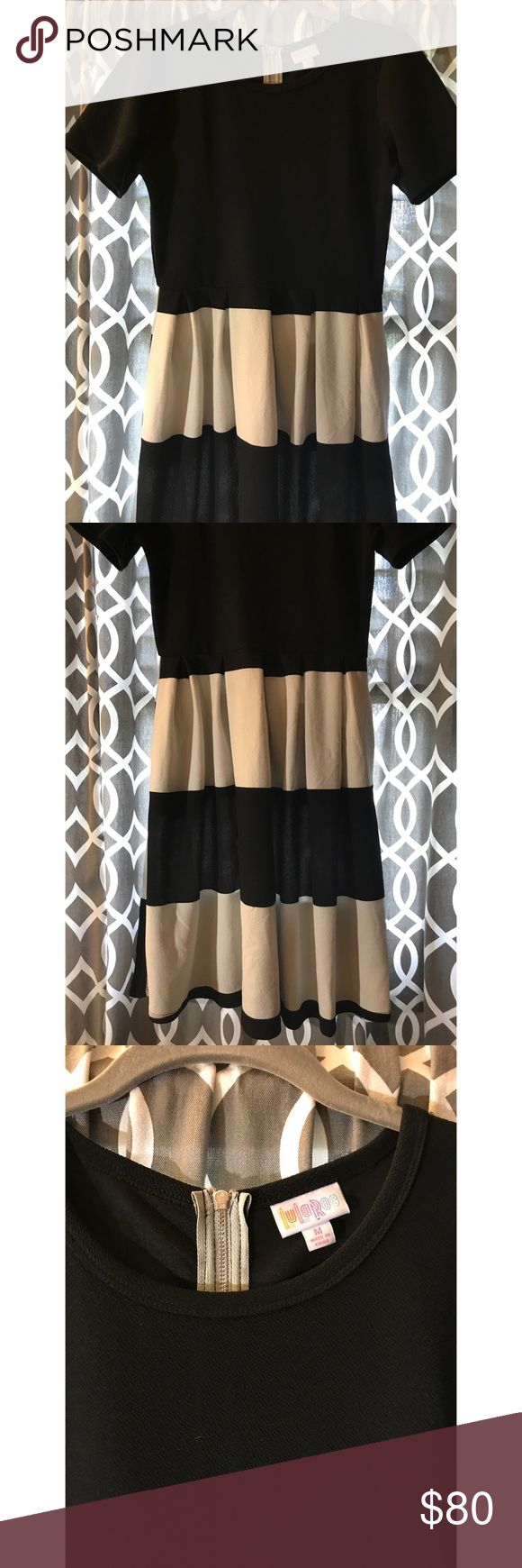 NWOT LuLaRoe Amelia Dress Never worn! Black top with large black and white stripes on the bottom. GORGEOUS for anybody or anywhere! LuLaRoe Dresses Midi