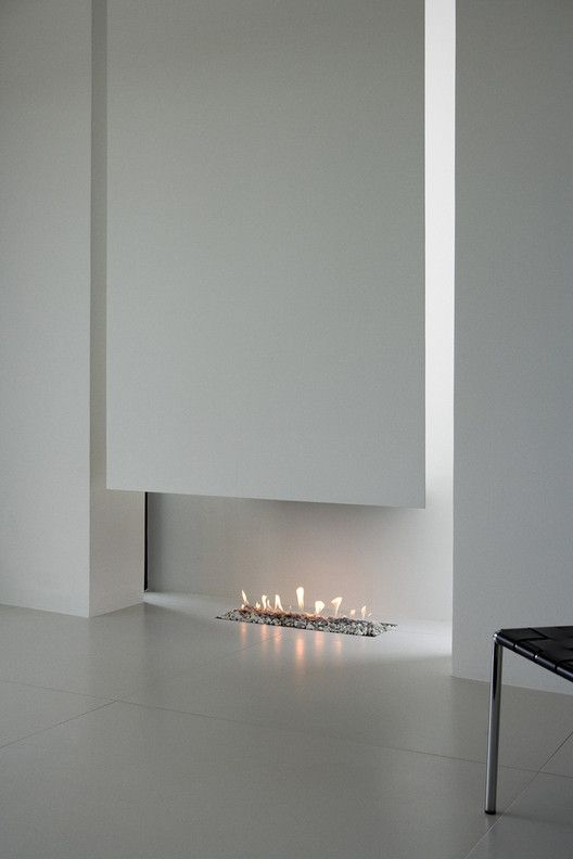 Minimal, low-profile fireplace pit // B25 House,© Rafael Pinho