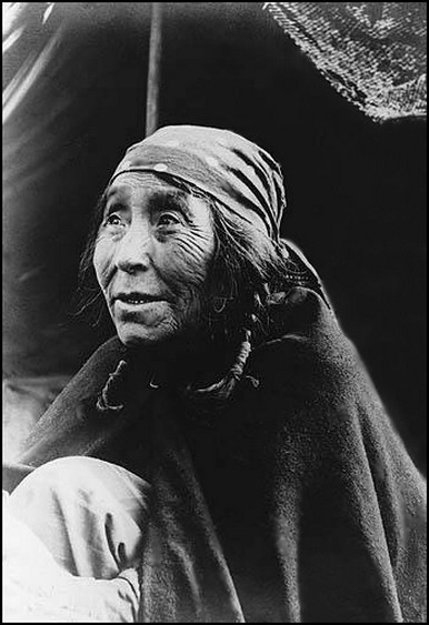 "Kwakiutl woman named Cla-lish, Fort Rupert, British Columbia, 1899. Kwakiutl is part of the Kwakwaka'wakw Nation. The proper name is Kwagu'l, in English ""Smoke-Of-The-Word"" Kwakiutl is an anglicized variant. The first documented contact was with Captain George Vancouver in 1792. Disease, from direct contact with European settlers along the West Coast of Canada, reduced the Kwakwaka'wakw population during the late 19th and early 20th century. Their population dropped by 75% between 1830-1880."