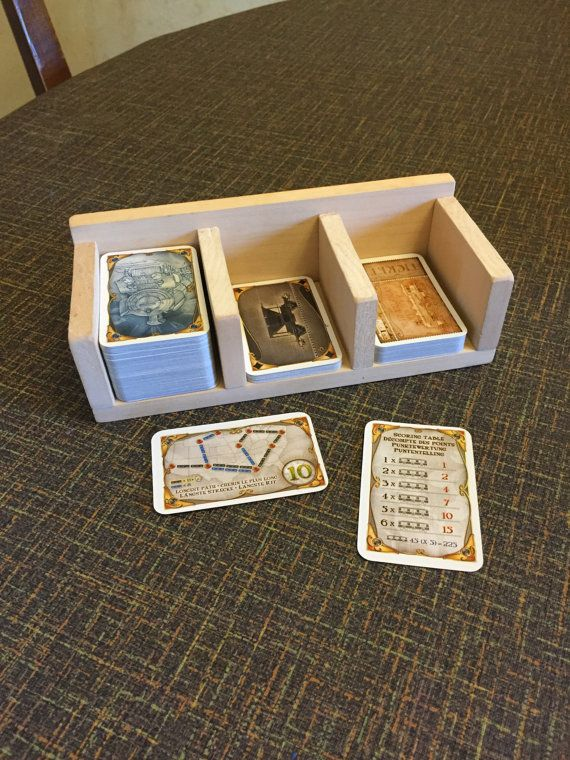 Handmade Ticket to Ride deck holder, can be custom sized for any card size. Picture shows the standard small card size for Ticket to Ride US. Joints are nailed and glued for high sturdiness. Made out of basswood. Can be used for any game that uses cards. Let me know what size your cards are, and how many card spaces you want and I can customize one for you.