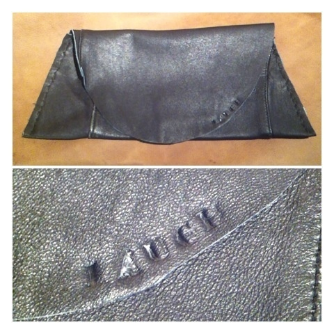 """Recycled Genuine Leather Clutch! Hand stitched and stamped with the word """"LAUGH"""" this clutch is $50 (medium sized black). All of my items are hand made and no two are alike. I have more sizes and colors available. Will do custom orders upon request.  Check out all my items at  Onelovegypsy.blogspot.com"""