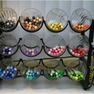 Wine rack with large cups for art supply storage. Great idea for