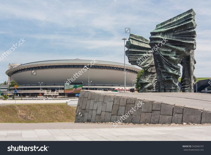 Katowice, Poland - July 10, 2016: Symbols of the city of Katowice. Silesian Insurgents Monument and Spodek - sports and entertainment hall.