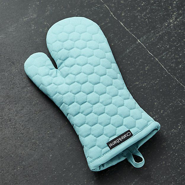 Shop Aqua Blue Oven Mitt.  Our very own oven mitt and pot holder accents the kitchen in cheerful aqua blue with fresh honeycomb quilting.