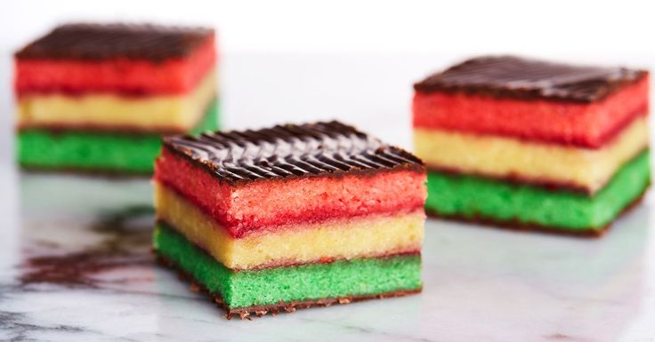 Layers of almond cake are sandwiched with raspberry jam before getting coated in chocolate for the prettiest and most delicious rainbow cookies you've ever had.