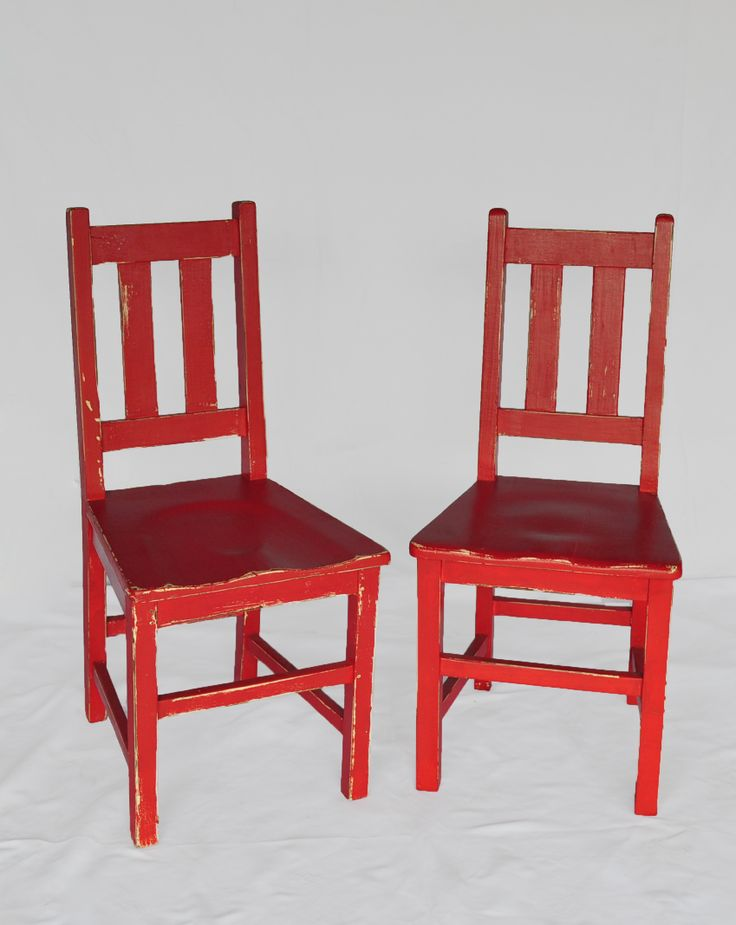 Low back old school chairs in red enamel: These old school chairs typically have two slats in the back, a solid seat, came in two height variants and were made from imported teak. #AntiqueShops #Johannesburg #SouthAfrica #Furniture #Chairs #Teak #SchoolChairs