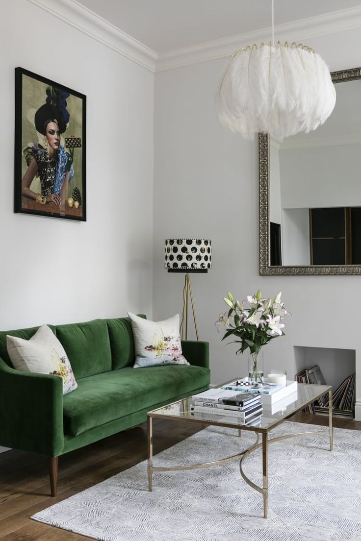 Velvet is really having a moment, paticularly when it comes to sofas. And what could be more stylish than a velvet sofa in this year's Pantone Colour of the Year, Greeney. Against a white background, the colour looks amazing.