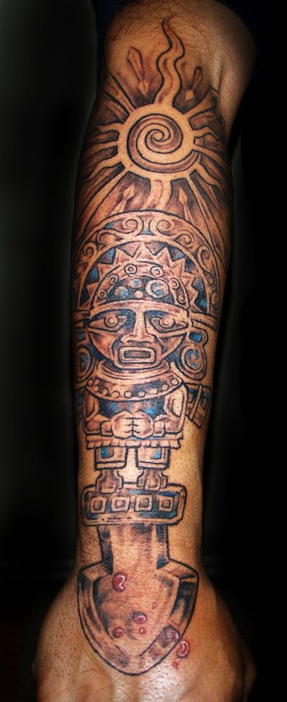 Definitely! my tattoo.... peruvian tumi wth the sun/