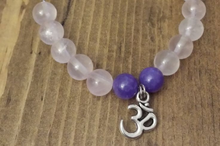 Rose Quarts and Amethyst with an Ohm Charm by NidraBeads on Etsy