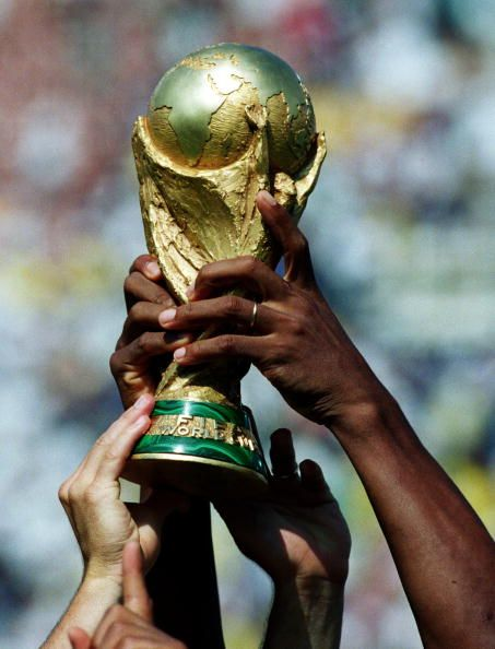 Brazil get their hands on the trophy after winning the World Cup Final between…