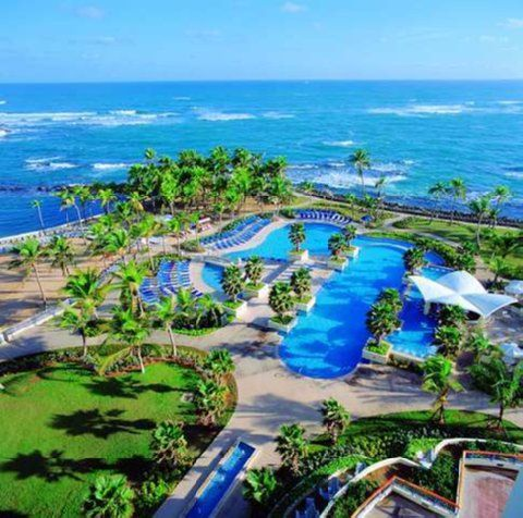 The Caribe Hilton hotel one of the most luxurious hotels in Puerto Rico is set on an exclusive peninsula made up of 17 acres of lush tropical gardens.
