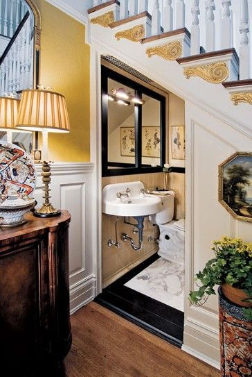 Powder room under stairwell... - http://www.homedecoratings.net/powder-room-under-stairwell