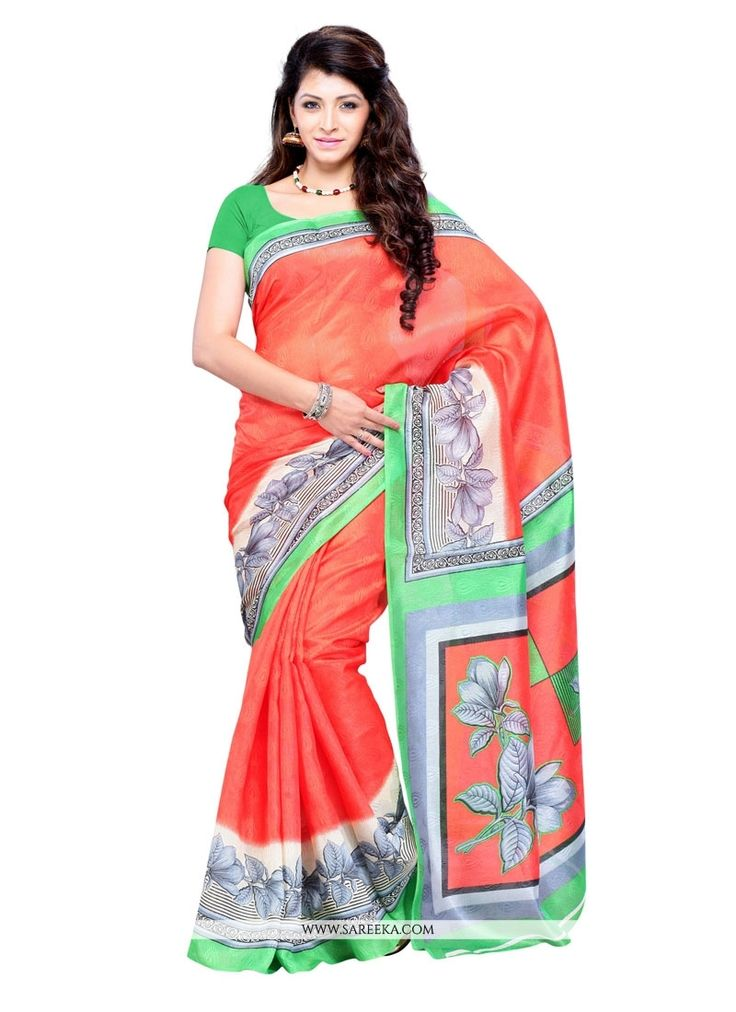 Rich look attire to give your a right choice for any party or function. Include your self of the glamour of a season with this elegant multi colour art silk casual saree. The appealing print work thro...