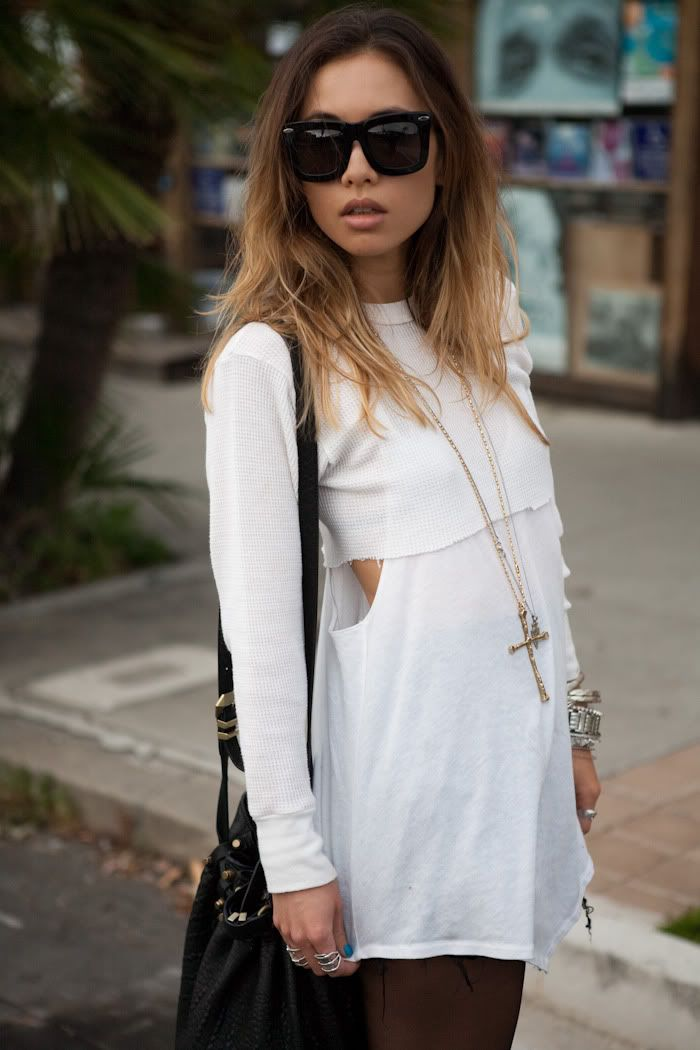 Rumi Neely is wearing all white: A cut up tank top from TVCA, ruffle shorts fom UO, bag from Alexander Wang and sunglasses from Grey Ant