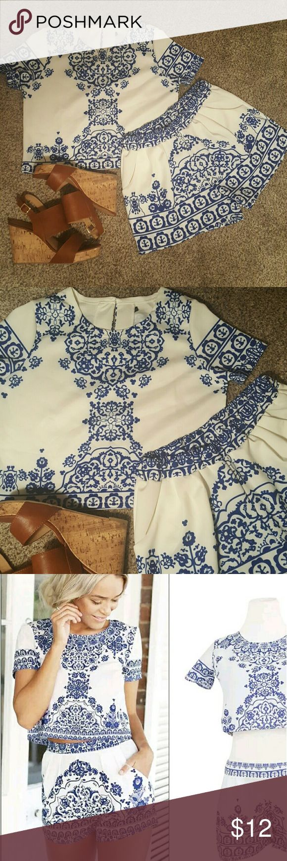 Blue and White Porcelain Crop Top and Shorts Set Adorable Blue and White Crop Top and Shorts Set Worn only once during a trip Crop top is a little longer and fits like the model in the 3rd pic.  Says size Large but it fits like a Medium Tops Crop Tops