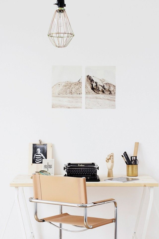 Soft leather desk chair in a small, bright office space