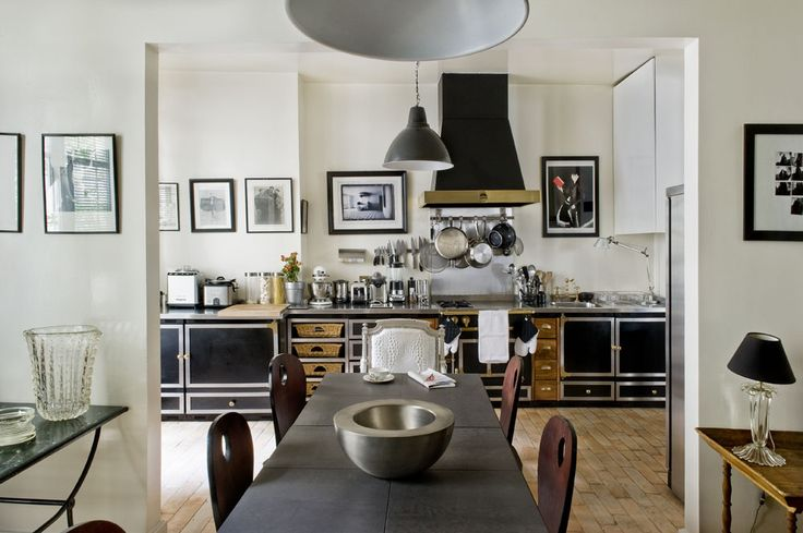 black La Cornue kitchen with hanging pots and brass hood // kitchens