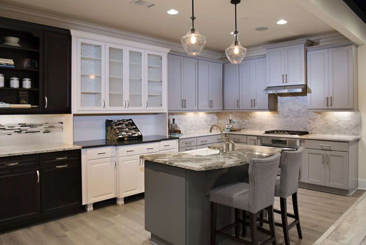 These kitchens in our design studio feature the Wellborn cabinets in coffee, glacier, and dove as well as the colonial pendant lighting.
